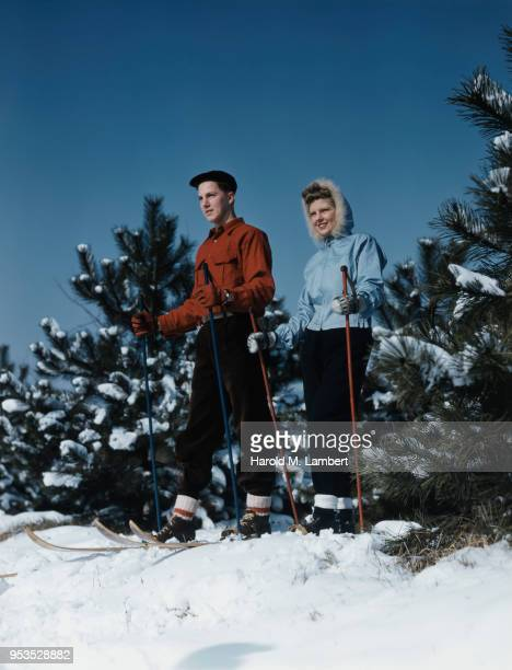YOUNG COUPLE GETTING READY TO SKI