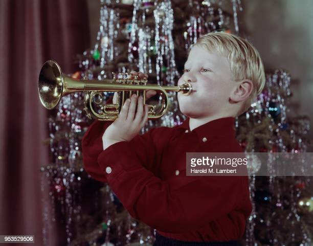 BOY PLAYING WITH TRUMPET