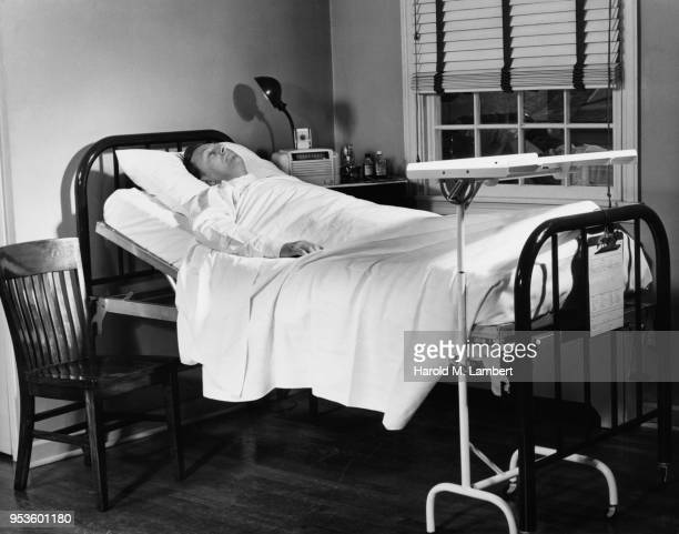 PATIENT LAYING ON HOSPITAL BED