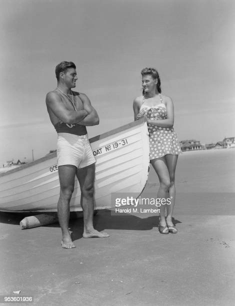 COUPLE STANDING NEAR BOAT