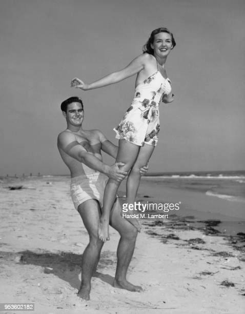 YOUNG COUPLE ENJOYING THE BEACH