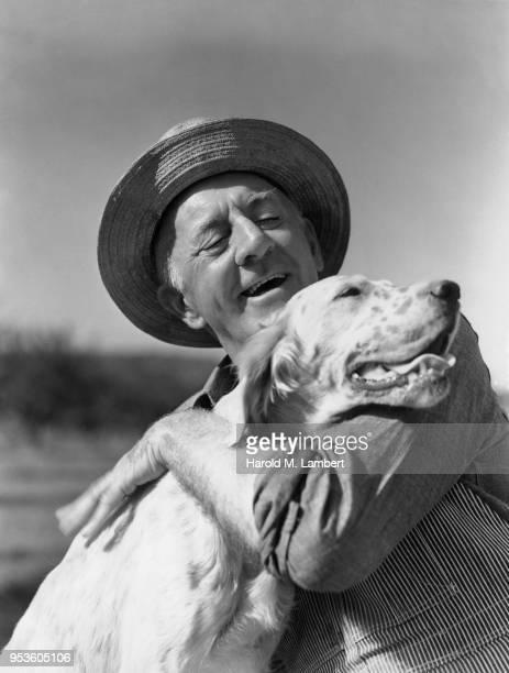 SENIOR MAN SMILING WITH HIS DOG