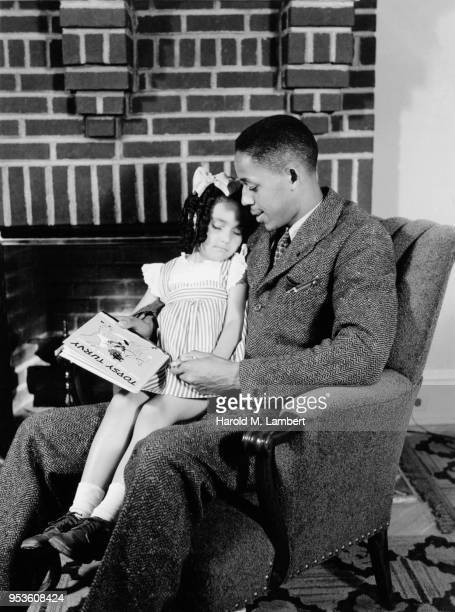 GIRL SITTING ON FATHERS LAP AND SLEEPING