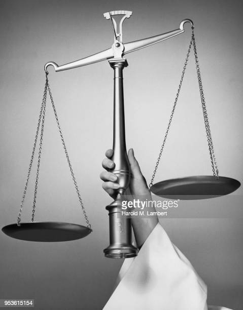 MAN HOLDING SCALE OF JUSTICE