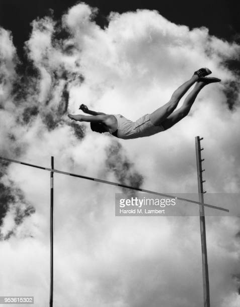ATHLETE JUMPING OVER HIGH BAR