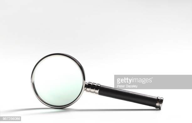 magnifying glass on white - 虫メガネ ストックフォトと画像