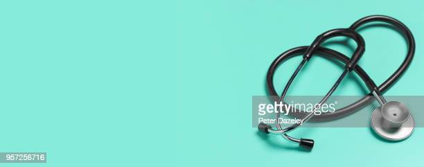 stethoscope with copy space - scrutiny stock pictures, royalty-free photos & images