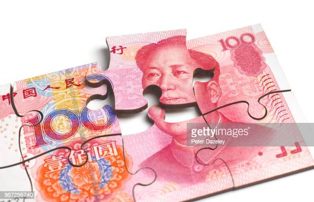 chinese yuan note breaking apart - dismantling stock pictures, royalty-free photos & images