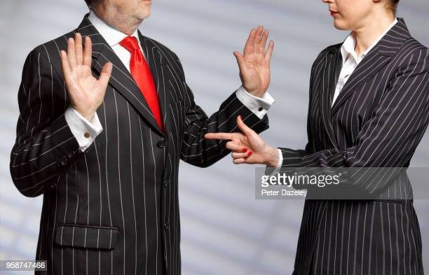 accused man holding up hands - sex discrimination stock photos and pictures
