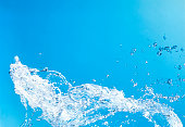splash water against blue background with