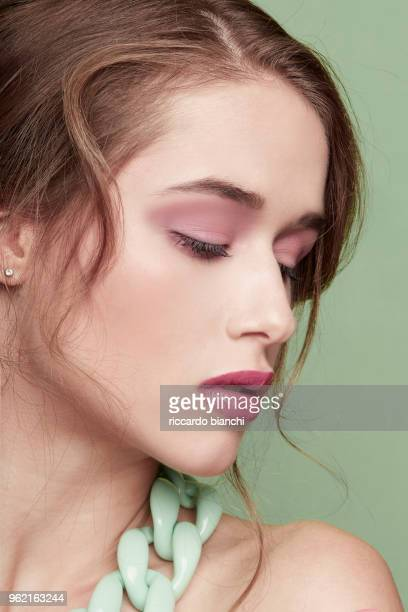 BRUNETTE WITH PINK LIPS AND PINK AND GREEN CHAIN NECKLACE