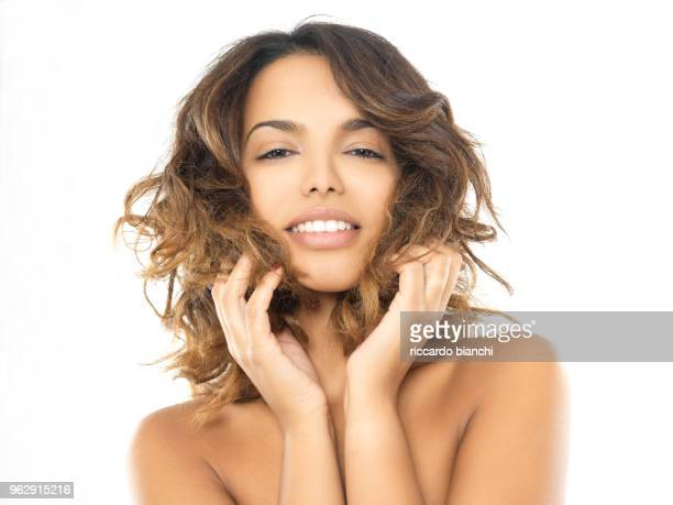 bunette woman with brown eyes smiling - lap body area stock photos and pictures