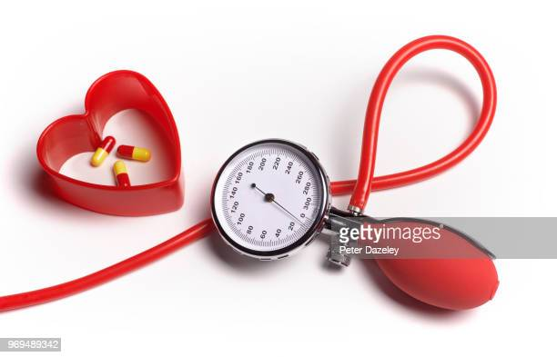 heart pills with blood pressure monitor - anticoagulant stock pictures, royalty-free photos & images