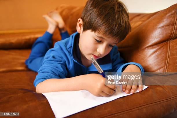 six year old boy doing his homework - handwriting stock pictures, royalty-free photos & images