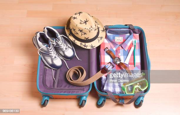 man packing for vacation - city break stock pictures, royalty-free photos & images