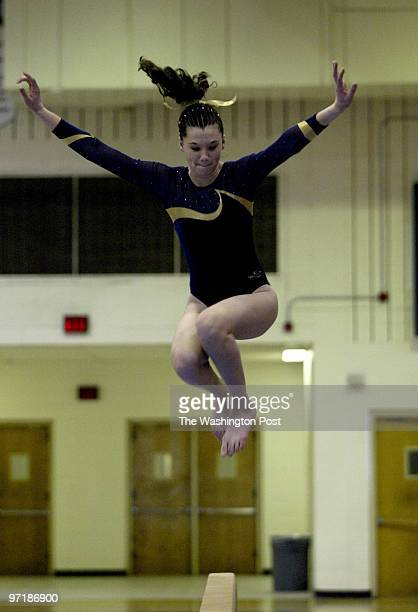 S KAITLIN HOEY ON THE BALANCE BEAM
