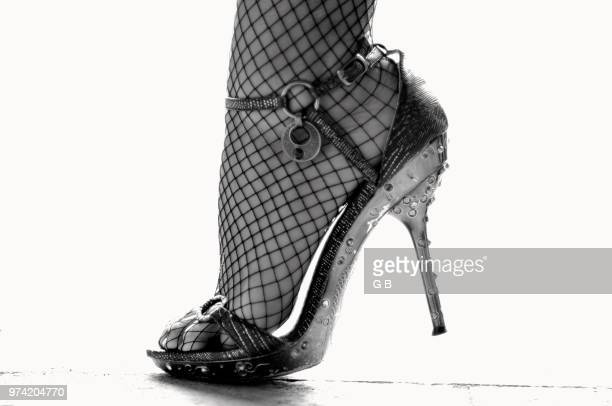 f e t i s h - fishnet stockings stock pictures, royalty-free photos & images