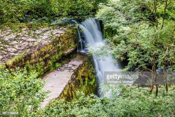 uk-wales-ystradfellte-ystradfellte falls - brook mitchell stock pictures, royalty-free photos & images