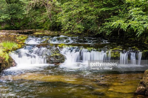 uk-wales-ystradfellte-cascades leading to ystradfellte falls - brook mitchell stock pictures, royalty-free photos & images