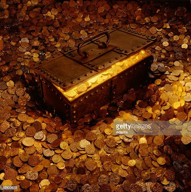 TREASURE CHEST SURROUNDED BY AND FULL OF COINS