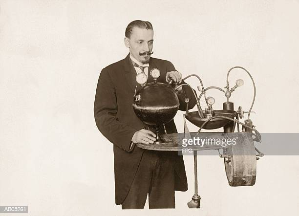 perpetual motion machine - inventor stock pictures, royalty-free photos & images