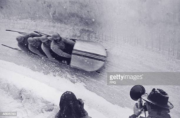 group of bobsleighers onarun - bobsleigh stock pictures, royalty-free photos & images