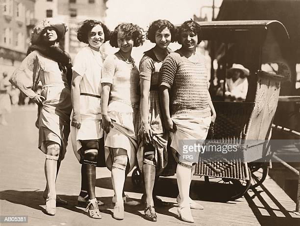 line of women showing their garter belts / circa 1920's - roaring 20s stock photos and pictures