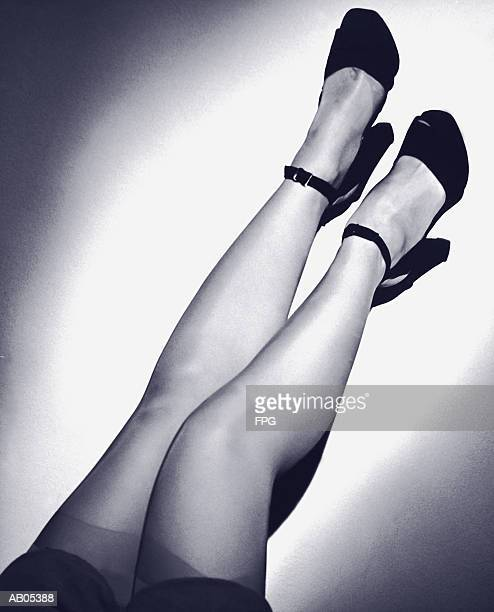 woman's legs, in stockings & shoes with ankle straps - human leg stock photos and pictures