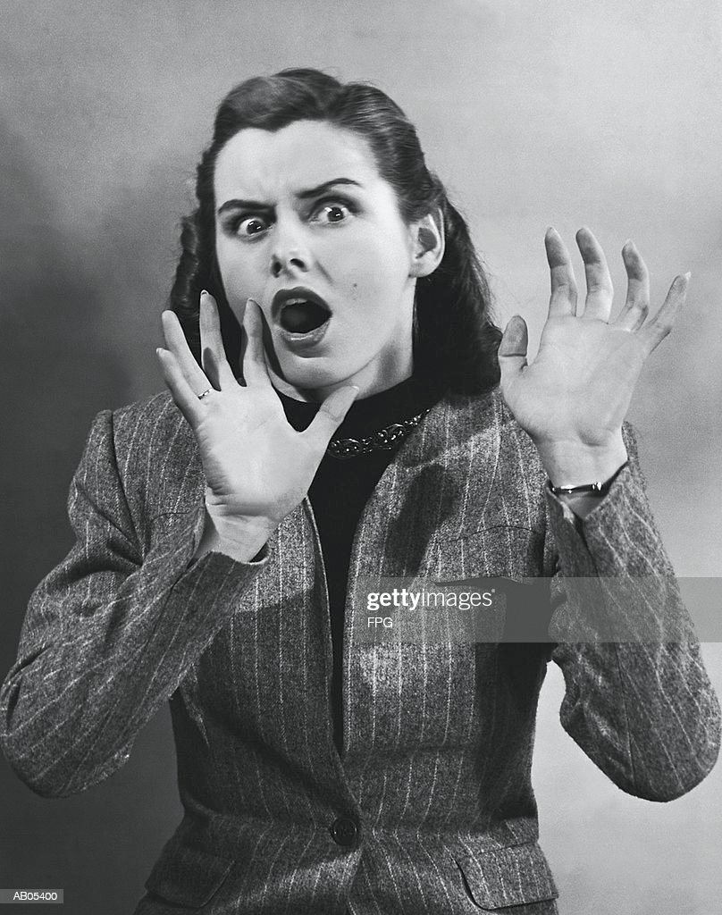 PORTRAIT / WOMAN WITH SHOCKED EXPRESSION GESTURING WITH HANDS : Stock Photo