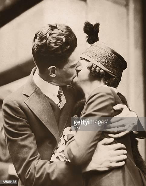 COUPLE EMBRACING / CIRCA 1920'S