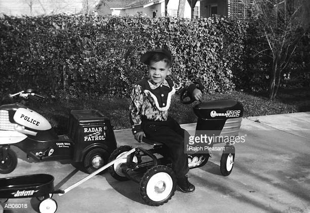 BOY ON TOY TRACTOR, 1950'S
