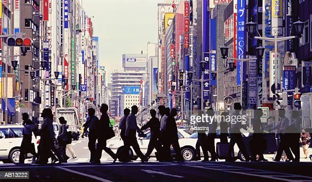 PEDESTRIANS CROSSING STREET IN GINZA DISTRICT OF TOKYO, JAPAN