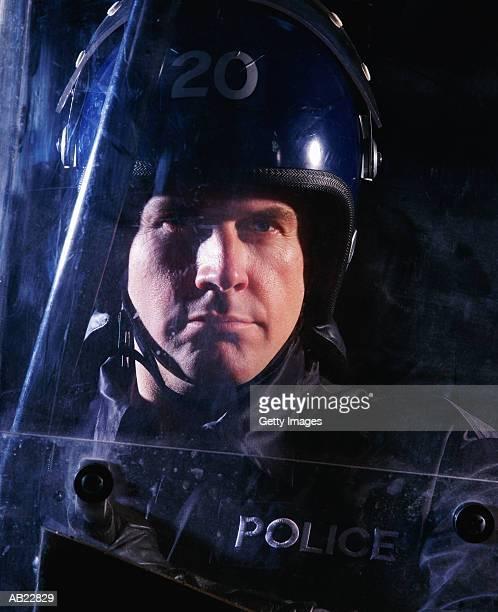 CLOSE-UP OF RIOT POLICEMAN