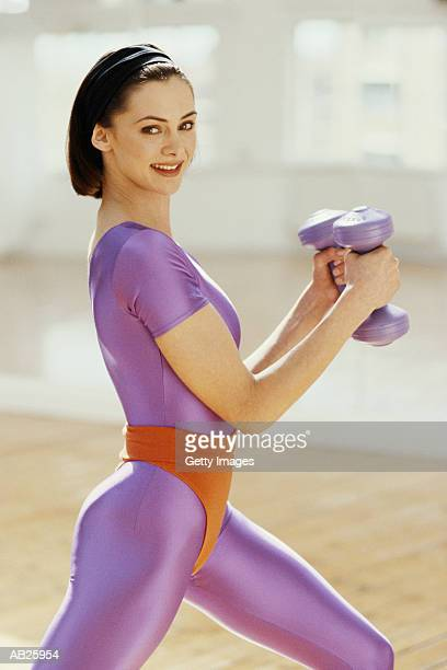 WOMAN WITH HAND WEIGHTS.