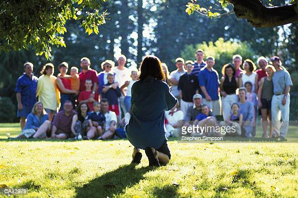 photographer taking photo - family reunion stock pictures, royalty-free photos & images