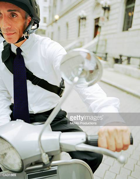 US, GEORGIA, ATLANTA, BUSINESSMAN COMMUTING ON MOTOR SCOOTER