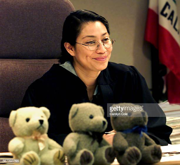 ME0513adopt4cc Judge Marilyn Martinez smiles after finalizing one of the many adoption proceedings she heard on Saturday May 13 2000 as part of...