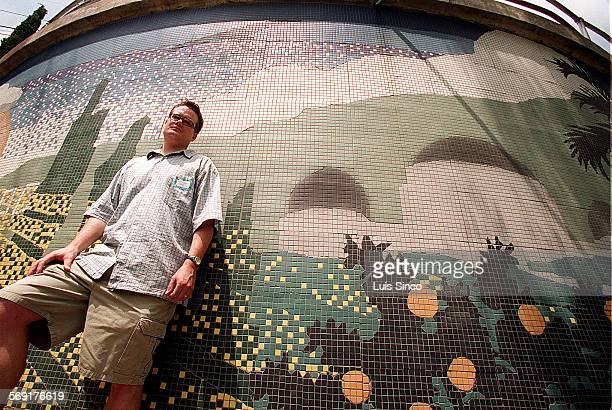 ME0617mural2LS Artist Lee McVetta stands beside his tile mural of the Griffith Observatory which adorns stairway connecting Bonvue Avenue and...