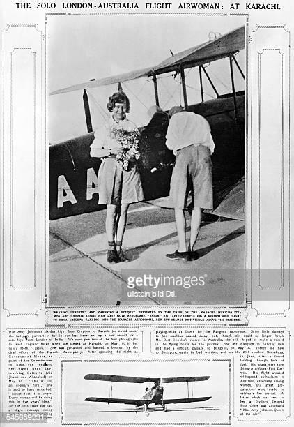 *Fliegerin GBnach der Ankunft in Karachi auf ihrem Alleinflug von London nach Darwin steht in Shorts vor ihrem Gipsy Moth Doppeldecker 'Jason'aus...