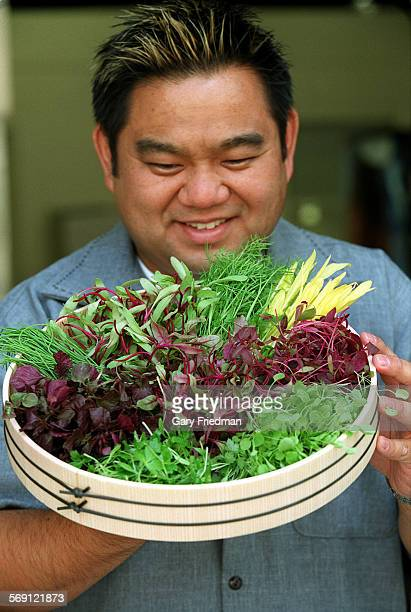 FO0628micro2gf Brian Hashizume with examples of microgreens as prepared and shipped by his company Japan California Products in downtown LosAngeles