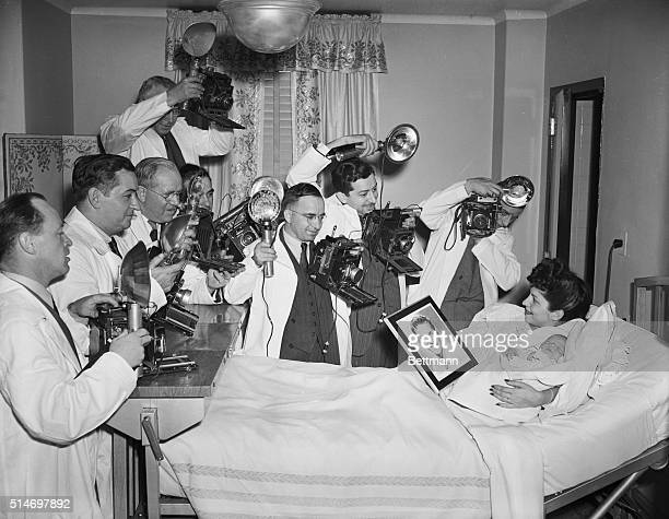 Jersey City NJ Photographers had to assume the garb of men in white when they photographed Mrs Frank Sinatra and her baby son who was born yesterday...