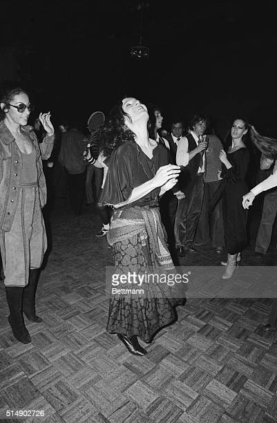 New York NY Margaret Trudeau wife of Canada's Prime Minister Pierre Trudeau does some fancy stepping at Studio 54 a New York City disco during a...