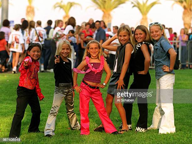 SO0729spears1AS–– Young girls show off their fashion prior to the Britney Spears concert Saturday July 30 at the Verizon Wireless Amphitheater left...