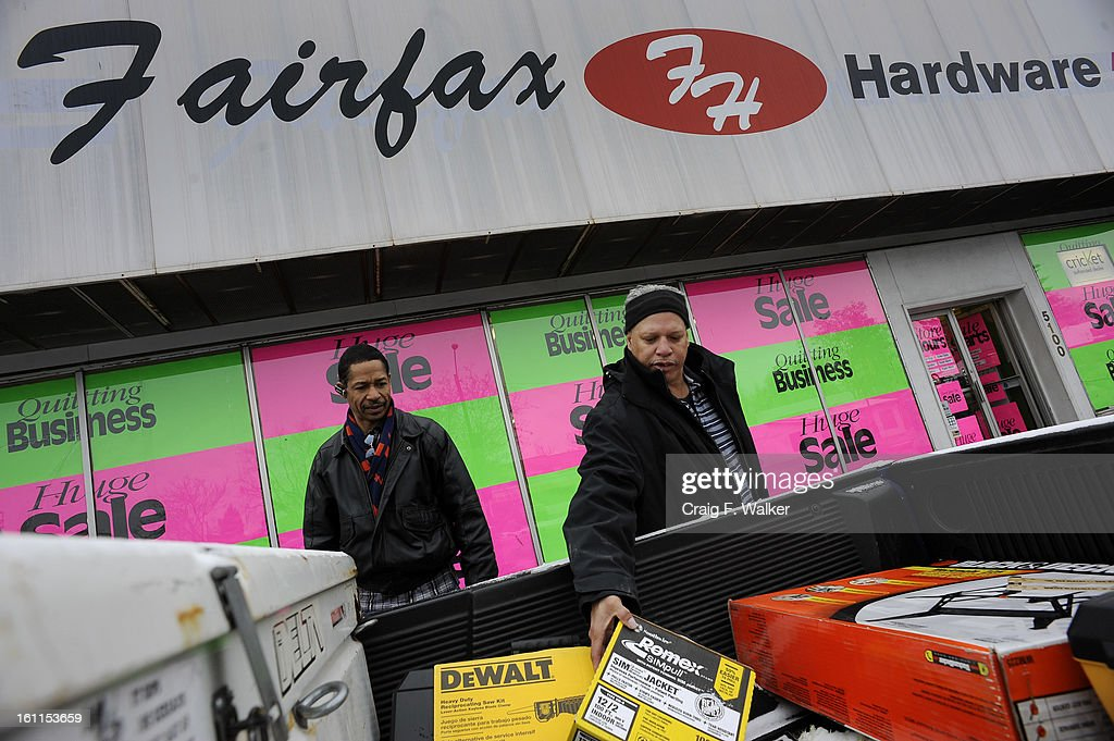 """012810_hardware_CFW- Michael Ashley and Bishop Scott, right, load items , just bought at Fairfax Hardware, into their truck. Bishop says he is sorry to see the store closing, """"I've been coming here for 20 years- not I gotta go to Home Depot."""" Steve Shaw h : News Photo"""