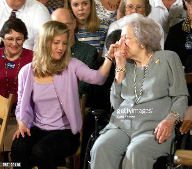 Gore3GF–Vice President Al Gore's mother Pauline kisses the hand of her granddaughterKarenna as Gore and his running mate Sen Joseph Lieberman speak...