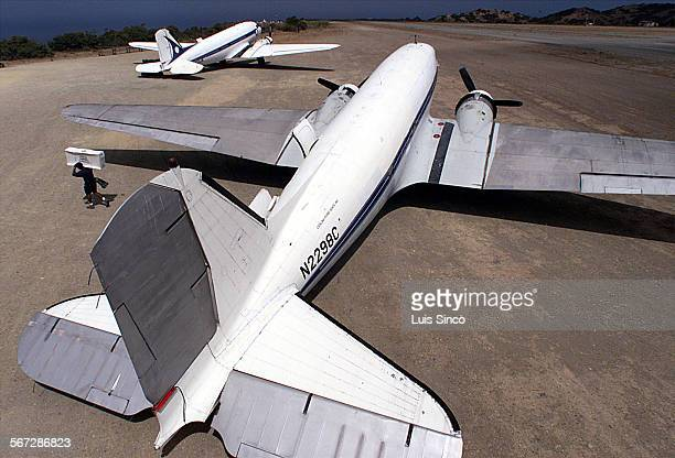 ME0831airline1LS A cargo handler unloads supplies from one of two 55–year–old DC–3s that Catalina Flying Boats operates between Long Beach and Santa...