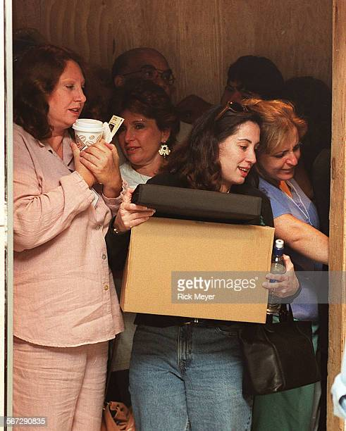 ME0911return3KH Photo shows employees crowding into a elevator as they move back into the LA Jewish Federarion building The building was rebuilt...
