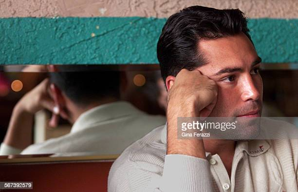 Oscar3.GF–Oscar De La Hoya ponders a thought while being interviewed in an east Los Angeles restaurant, recently. He's been in a legal battle with...