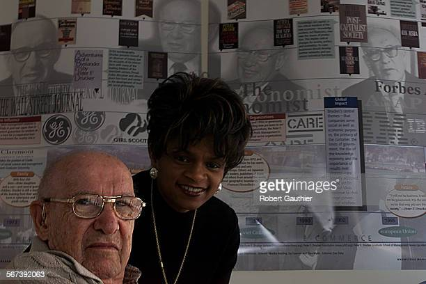 FI1010career2RG –– Billionaire Peter Drucker with Doris Cope at his library on the Claremont College campus Tuesday October 10 2000 Drucker provided...