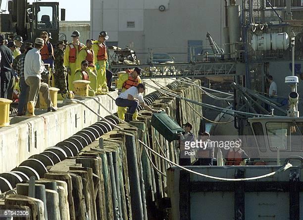 AircrashOxnardCalifornia01Feb00 Us Coast Guardsmen Unload Debris Gathered From The Ocean Febuary 01 1999 From Alaska Airlines Flight 261 Which Crash...